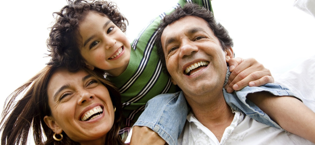 family of 3 smiling and laughing together